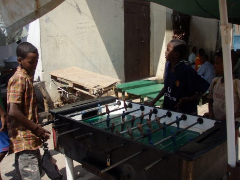 African kids playing table football in Djibouti City